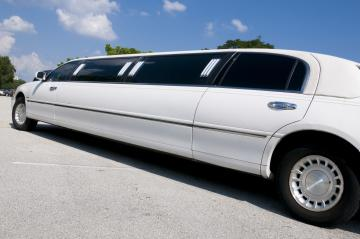 A beautiful white stretch limousine.