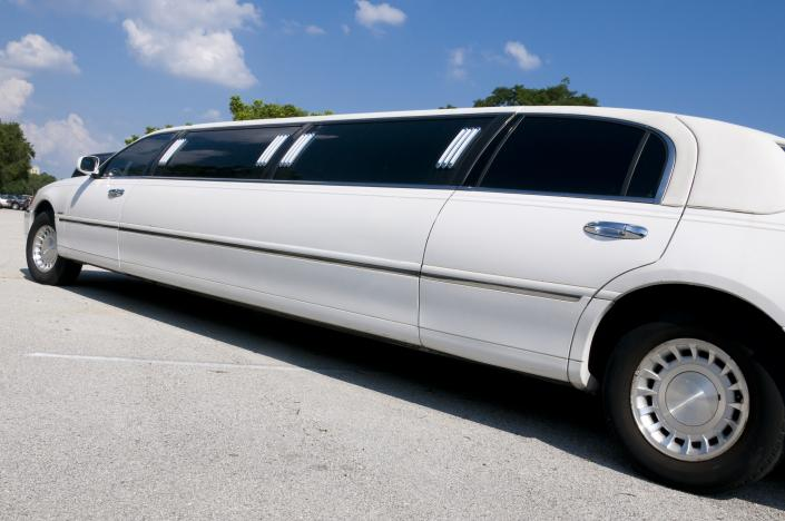 [Image: A beautiful white stretch limousine.]
